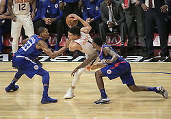 October 21, 2017 - Los Angeles, California, U.S - (C) Devin Booker #1 of the Phoenix Suns is surrounded by Wesley Johnson #33 and Lou Williams #23 of the Los Angeles Clippers during their regular season game on Saturday October 21, 2017 at the Staples Center in Los Angeles, California. Clippers defeat Suns, 130-88. (Credit Image: © Prensa Internacional via ZUMA Wire)