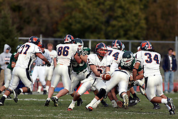 10 November 2007: Reserve quarterback Sean Norris holds out the ball for Rocky Gingg. This game between the Wheaton College Thunder and the Illinois Wesleyan University Titans was for a share of the CCIW Championship and was played at Wilder Field on the campus of Illinois Wesleyan University in Bloomington Illinois.