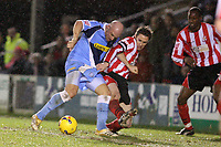 Photo: Pete Lorence.<br />Lincoln City v Wycombe Wanderers. Coca Cola League 2. 30/12/2006.<br />Tommy Mooney desperately tries to score in yet another goal mouth scramble.