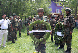 May 10, 2017 - Kulgam, Jammu And Kashmir, India - Funeral procession of lieutenant rank army officer Umer Fayaz Parry resident of Sursunoo Yaripora area of Kulgam district who was found killed in Shopain district of South Kashmir on last night ( 03/05/2017). Lt Umer Fayaz from Kulgam was on leave to attend a marriage ceremony, abducted and shot by militants last night  (Credit Image: © Aasif Shafi/Pacific Press via ZUMA Wire)