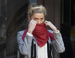 © Licensed to London News Pictures. 21/07/2020. London, UK. American actor AMBER HEARD adjusts her face mask as she arrives at the High Court in London where Johnny Depp is in a legal dispute with UK tabloid newspaper The Sun over allegations he assaulted his former wife, Amber Heard. Photo credit: Peter Macdiarmid/LNP