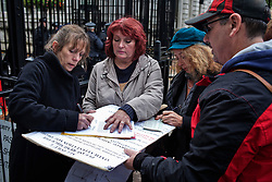 © Licensed to London News Pictures. 05/11/2013. London, United Kingdom. An Anti-Fracking delegation made by dairy farmers prepare to get in Downing Street to discuss about the ground contamination affecting their milk due to shale gas-extraction. Photo credit : Andrea Baldo/LNP