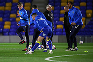 AFC Wimbledon midfielder Jack Rudoni (12), AFC Wimbledon defender Terell Thomas (6) warming up prior to kick off during the EFL Sky Bet League 1 match between AFC Wimbledon and Peterborough United at Plough Lane, London, United Kingdom on 2 December 2020.