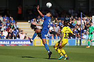 AFC Wimbledon defender Tennai Watson (2) battles for possession with Oxford United midfielder Ricky Holmes (12) during the EFL Sky Bet League 1 match between AFC Wimbledon and Oxford United at the Cherry Red Records Stadium, Kingston, England on 29 September 2018.