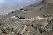 Cars driving on unsurfaced road, Atlantic Ocean coast, Jandia peninsula, Fuerteventura, Canary Islands, Spain
