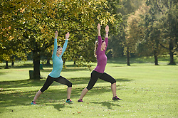Women exercising in park, Woerthsee, Bavaria, Germany