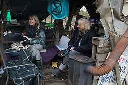 Harefield, UK. 13 January, 2020. Stop HS2 activists at the Colne Valley protection camp. Part of the camp was evicted by bailiffs last week. 108 ancient woodlands are set to be destroyed by HS2 and further destruction of trees in the Harvil Road area for the high-speed rail link is believed to be imminent.