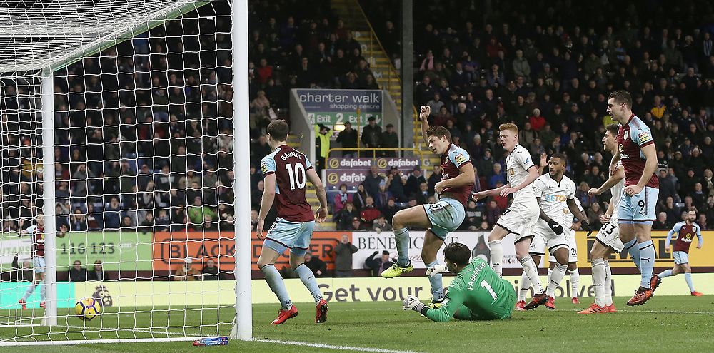 Burnley's James Tarkowski is caught off-side as he directs a loose ball past Swansea City's Lukasz Fabianski in the second half<br /> <br /> Photographer Rich Linley/CameraSport<br /> <br /> The Premier League - Burnley v Swansea City - Saturday 18th November 2017 - Turf Moor - Burnley<br /> <br /> World Copyright © 2017 CameraSport. All rights reserved. 43 Linden Ave. Countesthorpe. Leicester. England. LE8 5PG - Tel: +44 (0) 116 277 4147 - admin@camerasport.com - www.camerasport.com