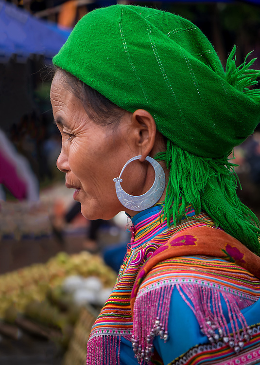 BAC HA, VIETNAM - CIRCA SEPTEMBER 2014:  Profile of Hmong woman at the  Bac Ha sunday market, the biggest minority people market in Northern Vietnam