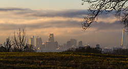 """Distand clouds loom over south west London as steam rises from the city's skyscrapers. The threatened snow from """"The Beast From The East"""" weather system doesn't materialise overnight in London leaving a crisp, clear morning, seen from Hampstead Heath in North London. London, February 27 2018."""