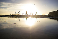 Group of young men plays soccer on a beach, Palawan Island, Philippines, Southeast Asia