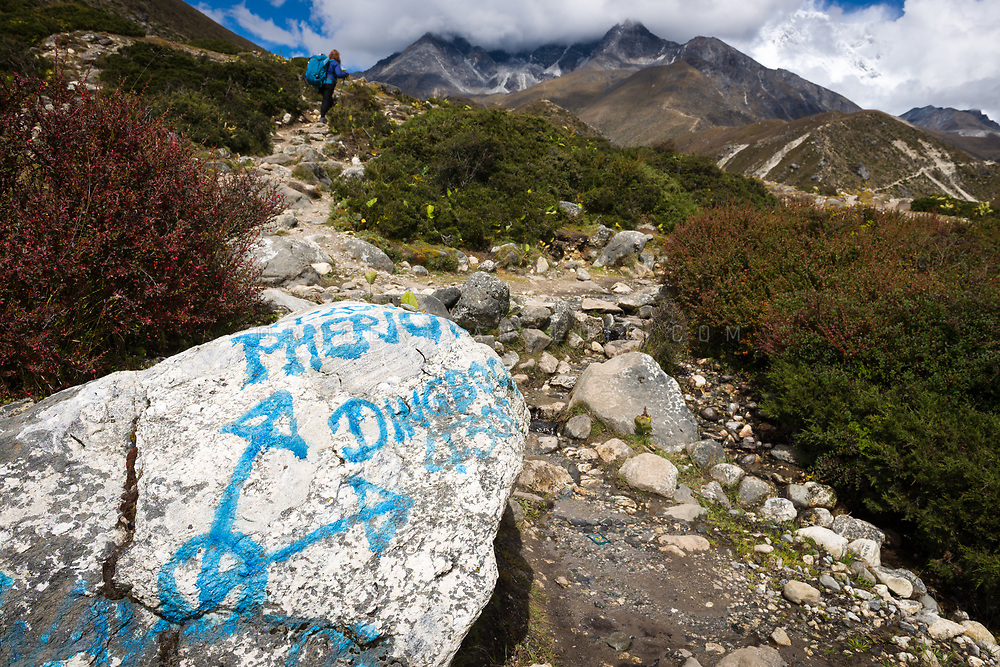 A stone marked with directions to Pheriche and Dingboche in the Nepal Himalaya. Photo © robertvansluis.com