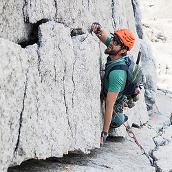 Jas Fauteux climbing the first pitch of Crack of Noon