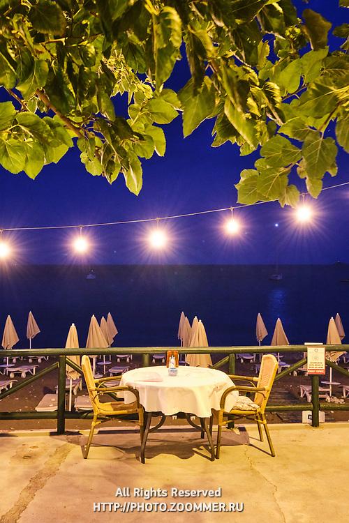 Empty restaurant table near sea in Turunc, Turkey