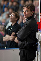 KELOWNA, CANADA - DECEMBER 6: Scott Hoyer, athletic therapist for the Kelowna Rockets, stands on the bench against the Everett Silvertips on December 6, 2013 at Prospera Place in Kelowna, British Columbia, Canada.   (Photo by Marissa Baecker/Shoot the Breeze)  ***  Local Caption  ***