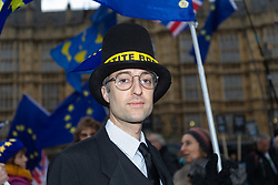 A Jacob Rees-Mogg lookalike gazes imperiously at the camera during protests outside the House of Commons in London as MPs debate Prime Minister Theresa Mays's Brexit Deal. London, January 15 2019.