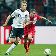 Turkey's Sabri SARIOGLU (R) and Germany's Holger BADSTUBER (L) during their UEFA EURO 2012 Qualifying round Group A matchday 19 soccer match Turkey betwen Germany at TT Arena in Istanbul October 7, 2011. Photo by TURKPIX
