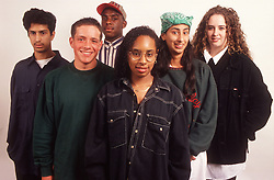 Multiracial group of teenage boys and girls standing together,