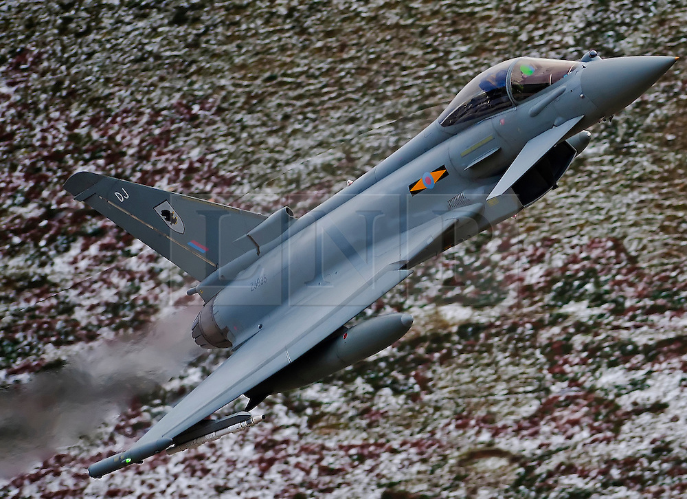 FILE PICTURE © Licensed to London News Pictures. 29/08/2013. North Wales Mach loop, UK. Typhoon F2 euro fighter low flying training  Wales Mach loop . Photo credit : Andrew Chittock/LNP