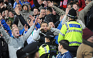Cardiff fans taunt Swansea City fans at the end of the game <br /> Barclays Premier League match, Cardiff city v Swansea city at the Cardiff city stadium in Cardiff, South Wales on Sunday 3rd Nov 2013. pic by Phil Rees, Andrew Orchard sports photography,