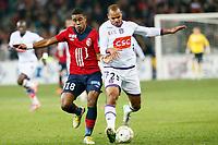FOOTBALL - FRENCH LEAGUE CUP 2012/2013 - 1/8 FINAL - LILLE OSC v TOULOUSE FC - 30/10/2012 - PHOTO CHRISTOPHE ELISE / DPPI - FRANCK BERIA (LOSC), DANIEL BRAATEN (TOULOUSE FC)
