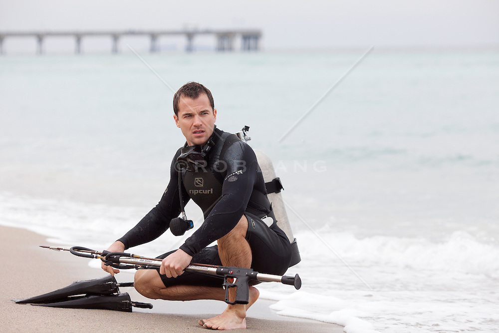 James Bond styled scuba diver with a speargun at the beach in Florida