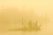 Heaavy morning fog on a northen lake with small island off the TransCanada Highway<br /> North Shore of Lake Superior<br /> Ontario<br /> Canada