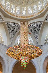 Interior of Sheikh Zayed Grand Mosque showing large ornate chandelier in Abu Dhabi United Arab Emirates