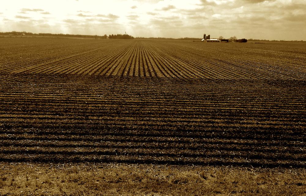 Amtrak Zephyr train land scape views,  Illinois  plowed fields.