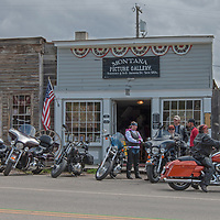 A motorcycle club rests in Virginia City, a ghost town that was once the capital of Montana Territory.