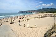 Praia do Guincho (Engels: Guincho Beach) is een populair Atlantisch strand aan de Portugese kust van Estoril.Dit strand was beroemd in de voortitels van de James Bond-film On Her Majesty's Secret Service, waarin James Bond Contessa Teresa de Vicenzo redt van een zelfmoordpoging en twee aanvallers in de branding verijdelt; het strand ziet er nog steeds uit zoals in 1969.<br /> <br /> <br /> Praia do Guincho (English: Guincho Beach) is a popular Atlantic beach located on Portugal's Estoril coast<br /> This beach was famously featured in the pre-titles sequence of the James Bond film On Her Majesty's Secret Service, wherein James Bond rescues Contessa Teresa de Vicenzo from a suicide attempt and foils off two attackers in the surf; the beach still looks as it did in 1969.