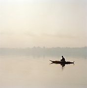 Fisherman in papyrus reed boat, otherwise known as a Tankwa, Lake Tana, North West Ethiopia