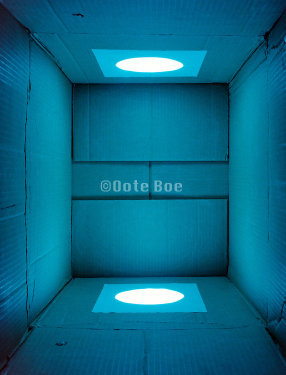 cardboard box with a monochrome blue light shining in it