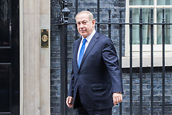 Downing Street, London, February 6th 2017. Israeli Prime Minister Benjamin Netanyahu arrives at 10 Downing Street for lunchtime talks with British Prime Minister Theresa May, with some confusion arising when Mrs May was not immediately on hand to welcome him. Minutes later the two PMs emerged for the traditional handshake photographs at the door of No 10.  PICTURED: Netanyahu makes his way to the door of Number 10 form his vehicle