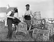 at Carna.  Boat Bulding with the Cloherty family..14/05/1959<br /> Preparing for their new boat - Sean O Cheoinin and his 11 year old son Padraig of Leitir Ard, carna, working on their lobster pots. They expected a new boat from Gael Linn.