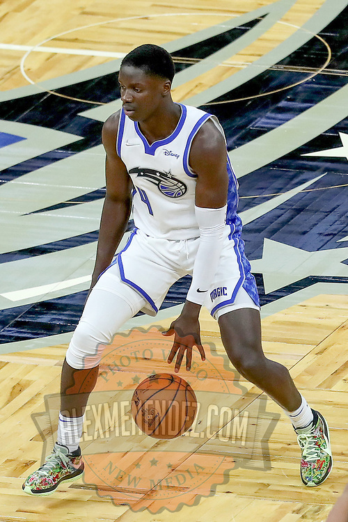 ORLANDO, FL - APRIL 12: Karim Mane #4 of the Orlando Magic controls the ball against the San Antonio Spurs at Amway Center on April 12, 2021 in Orlando, Florida. NOTE TO USER: User expressly acknowledges and agrees that, by downloading and or using this photograph, User is consenting to the terms and conditions of the Getty Images License Agreement. (Photo by Alex Menendez/Getty Images)*** Local Caption *** Karim Mane