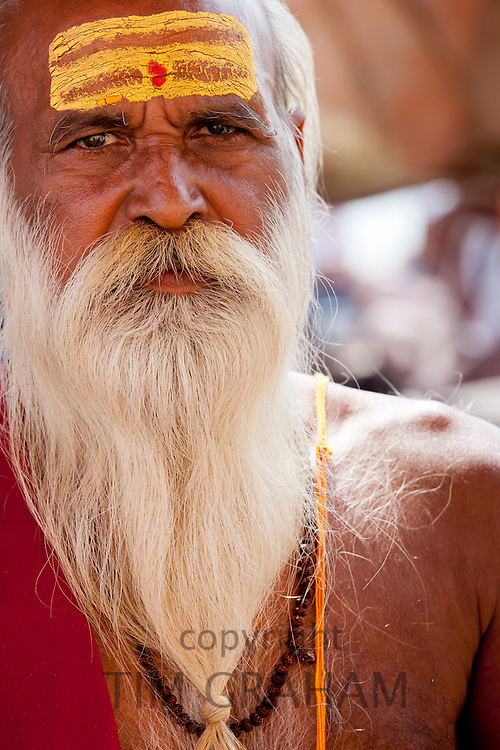 Hindu Sadhu holy man with traditional markings of symbol of Shiva in street in holy city of Varanasi, Benares, Northern India