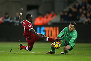 Lukasz Fabianski , the Swansea city goalkeeper makes a save to deny Sadio Mane of Liverpool. Premier league match, Swansea city v Liverpool at the Liberty Stadium in Swansea, South Wales on Monday 22nd January 2018. <br /> pic by  Andrew Orchard, Andrew Orchard sports photography.