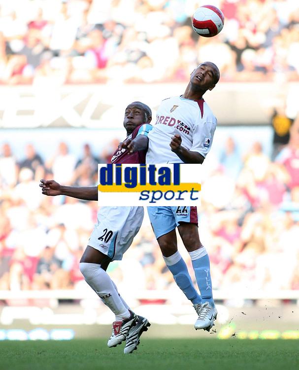 Photo: Chris Ratcliffe.<br /> West Ham United v Aston Villa. The Barclays Premiership. 10/09/2006.<br /> Luke Moore of Aston Villa clashes with Nigel Reo-Coker of West Ham.