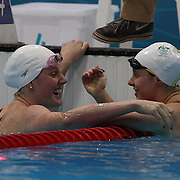 Missy Franklin, USA, with Belinda Hocking, Australia, (right)  in the Women's 100m backstroke heats during the swimming heats at the Aquatic Centre at Olympic Park, Stratford during the London 2012 Olympic games. London, UK. 29th July 2012. Photo Tim Clayton