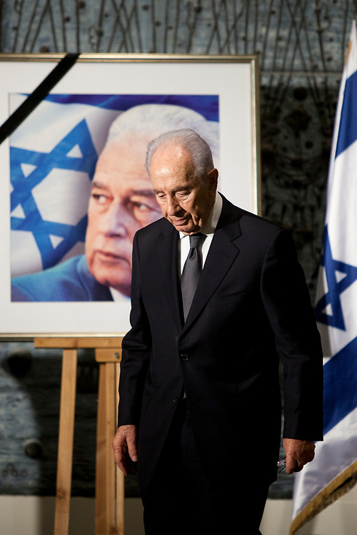Israel's President Shimon Peres walks past a picture of assassinated Israeli Prime Minister Yitzhak Rabin, during a memorial ceremony marking the 16th anniversary of Rabin's assassination, at the President's Residence in Jerusalem, Israel, on November 08, 2011. Rabin was shot and killed by a right-wing Jewish extremist on November 4, 1995.