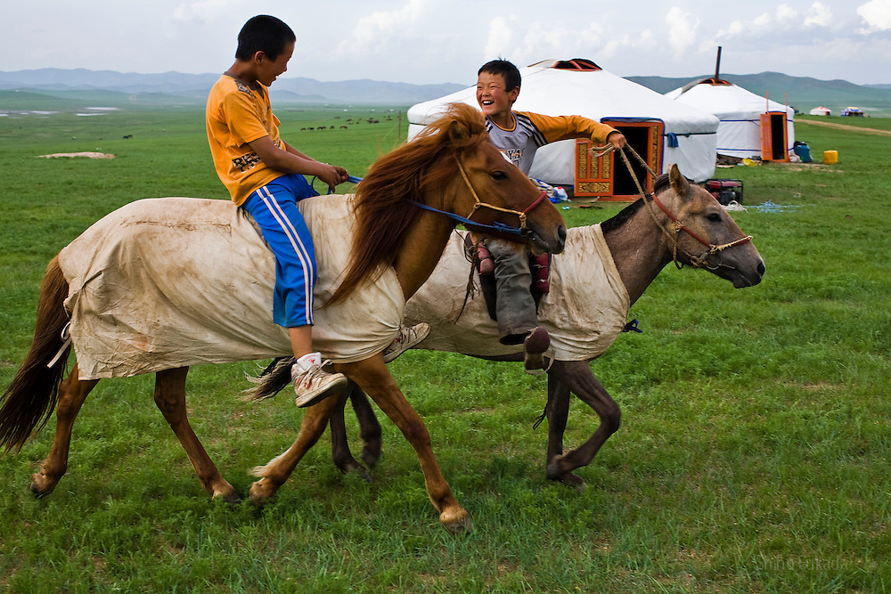 Boy jockeys ride horses in Khui Doloon Khudag, Mongolia, July 8, 2008. Participants of this weekend's horse race during Naadam festival gather the area to practce. Children from 5 to 13 are chosen as jockeys.