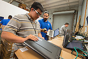 Sharpstown High School 2014 graduate Jairo Luna prepares laptops at a NetSync warehouse for distribution to classrooms, July 2, 2014. The Sharpstown PowerUp coordinator recommended Luna for the internship.