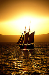 Cruising, Mediterranean, Europe, Greece, Santorini, sailing ship at sunset, Photo: crumed104  .Photo Copyright: Lee Foster, (510) 549-2202, lee@fostertravel.com, www.fostertravel.com