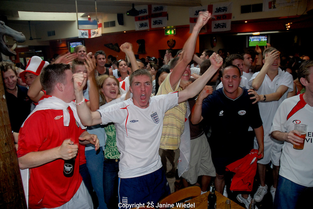 Young English football fans drinking and behaving badly in Westend pubs whilst watching World cup  match.