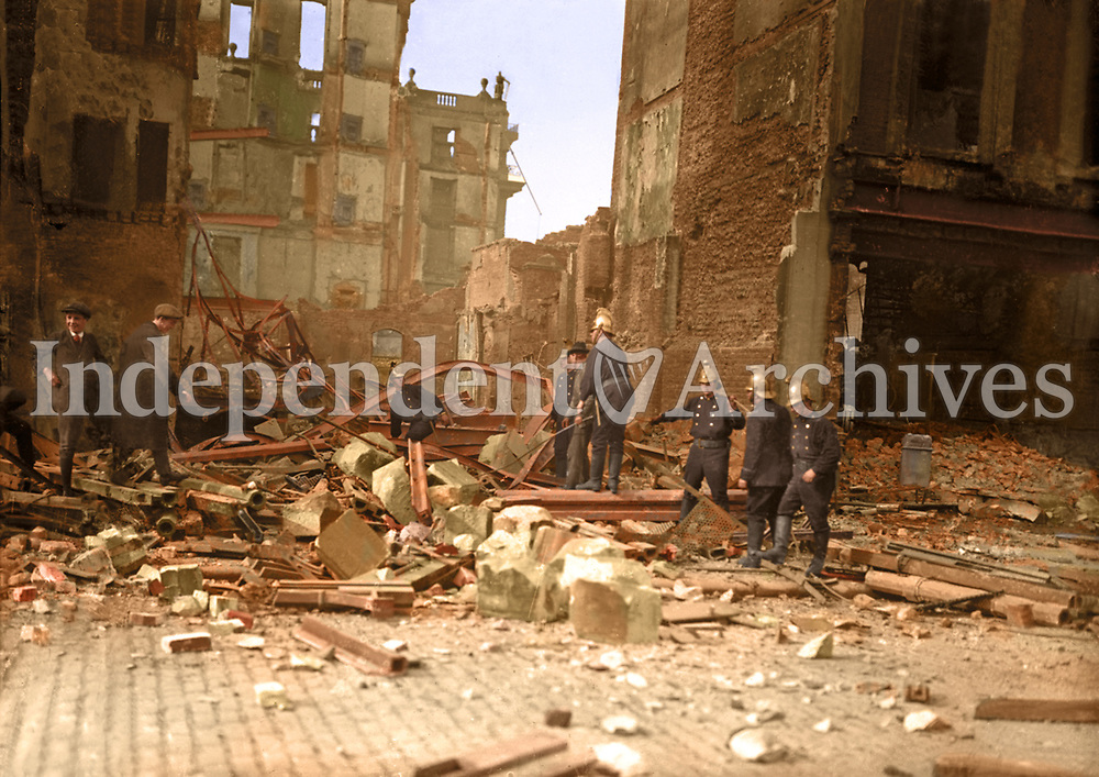 Members of Dublin Fire Brigade working in an unidentified building after the Rising. (Part of the Independent Newspapers Ireland/NLI Collection) Colourised by Tom Marshall (PhotograFix).