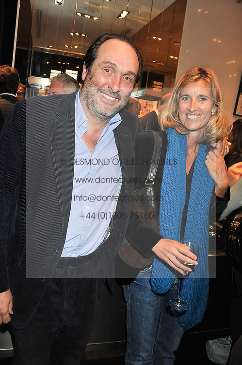 The HON.DAVID MACMILLAN and his wife ARABELLA at a private view of an exhibition 'Outside in Chelsea' held at Annoushka, 41 Cadogan Gardens, London SW3 on 2nd October 2012.