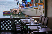 Restaurant over looking the Fishing boats in the Mikrolimano Marina, Piraeus, Athens, Greece