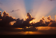 During a sunset in Antigua, a cloud formation is backlit creating these rays of light