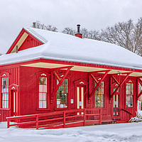 The Wayland Train Depot and railroad station in Wayland covered in a snowy winter wonderland. This Massachusetts historic landmark is located right next to the Mass Central Wayside Rail Trail in Wayland Center.<br /> <br /> New England country photography images of the Wayland Train Depot are available as museum quality photo, canvas, acrylic, wood or metal prints. Wall art prints may be framed and matted to the individual liking and interior design decoration needs:<br /> <br /> https://juergen-roth.pixels.com/featured/wayland-train-depot-station-juergen-roth.html<br /> <br /> Good light and happy photo making!<br /> <br /> My best,<br /> <br /> Juergen